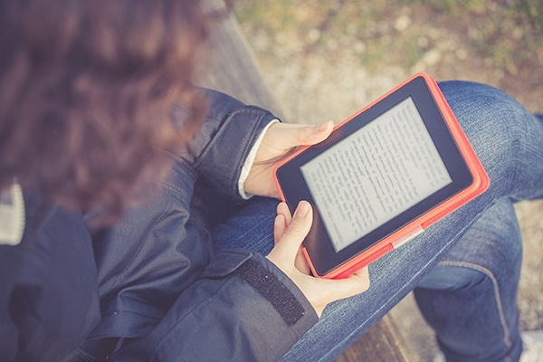 Student reading an eTextbook on tablet
